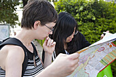Young chinese woman and german tourist with city map, Kunming, Yunnan, People's Republic of China, Asia