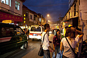 Young people and students at YuanXi street in the evening, shopping street with cafes and restaurants, Kunming, Yunnan, People's Republic of China, Asia