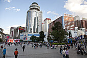 People at shopping street, modern city center of Kunming, Yunnan, People's Republic of China, Asia