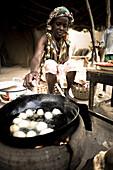 African woman frying dough balls, Djenna, Mali, Africa