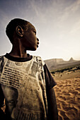 African boy in the sand dunes, Hombori, Mali, Africa
