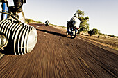 Motorcycles on a road in the sunlight, Mali, Africa