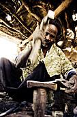 African blacksmith in a hut, Sangha, La Falaise de Bandiagara, Mali, Africa