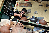 Man working at pottery Rufina in El Celcado, Gomera, Canary Isles, Spain, Europe