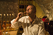 Proprietor Jürgen H. Krenzer testing apple sherry in the Apple Wine and Sherry Cellar at Rhöner Schau-Kelterei, Gasthof Zur Krone, Das Rhönschaf Hotel, Ehrenberg, Seiferts, Rhoen, Hesse, Germany