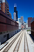 Public transport railway tracks, Willis Tower (formerly Sears Tower) in the background, Chicago, Illinois, USA