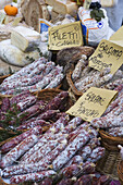 Salami stall at the market in Alba, Piedmont, Italy