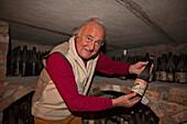 Giacomo Vico in his wine cellar, Canale, Roero, Piedmont, Italy
