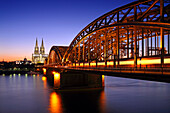 View over river Rhine in the evening light towards Cologne cathedral and the Hohenzollern Bridge, Cologne, Rhine river, North Rhine-Westphalia, Germany