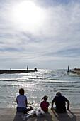 Family enjoying the sun at the seaside promenade, Namal section of Tel Aviv, Israel, Middle East