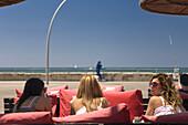 Women in a restaurant at the seaside promenade, Namal, Tel Aviv, Israel, Middle East