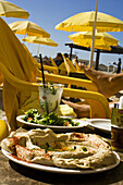 Plate with humous dish at Mezizim Beach, Tel Aviv, Israel, Middle East