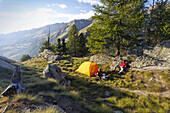 Hikers camping near Lago di Loie, Aosta Valley, Italy