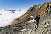 Man hiking, ascent to Col Lauson, Crête du Tuf, Gran Paradiso National Park, Aosta valley, Italy