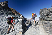 Hikers on summit of Col Lauson, Gran Paradiso National Park, Aosta Valley, Italy