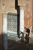 Tourist taking a photo, visiting the Saadian Tombs, Marrakech, Morocco, Africa