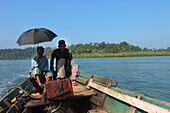 Local men in a boat on the way to Long Island, Baratang, Middle Andaman, Andamans, India