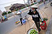 Two women carrying fruit and vegetables, Da Lat in the southern mountains, Vietnam