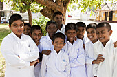 Sinhalese boys in their school uniforms in front of the Santagiri Dagoba, Tissamaharama, Sri Lanka, Asia