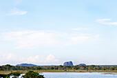 An elephant and other wildlife infront of the Elephant Rock, Yala National Park, Sri Lanka, Asia