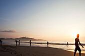 Fishermen in the morning at Talalla beach pulling in their fishing net, Talalla, Matara, South coast, Sri Lanka, Asia