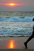 Jogger at sunrise at Talalla beach, Talalla, Matara, South coast, Sri Lanka, Asia