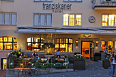 Franziskaner Hotel outdoor in Niederdorf, people, restaurants in summer, Switzerland, Zurich