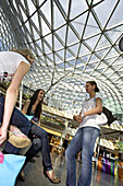 Young Polish women meet for shopping under the glass-roofed Zlote Tarasy shopping Complex, Warsaw, Poland, Europe