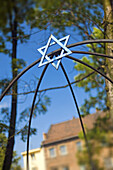 Jewish Star in courtyard on Szeroka in Jewish Kazimierz Quarter, Krakow, Poland, Europe