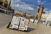 Artwork for sale on Main Market Square Rynek Glowny in front of St. Mary's Basilica Kosciól Mariacki, Krakow, Poland, Europe