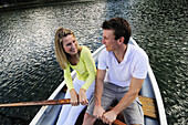 Young couple in rowboat, lake Lautersee, Mittenwald, Werdenfelser Land, Upper Bavaria, Germany