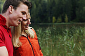 Young couple smiling, lake Lautersee, Mittenwald, Werdenfelser Land, Upper Bavaria, Germany