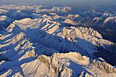 Wetterstein range with Zugspitzplatt and Blassengrat in foreground, Zugspitze, Jubilaeumsgrat and Alpspitze in middleground, Allgaeu range and Ammergau range in background, aerial photo, Garmisch-Partenkirchen, Wetterstein range, Bavarian alps, Upper Bava