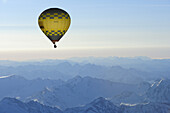 Hot-air balloon above snow-covered mountains, aerial photo, South Tyrol, Italy, Europe