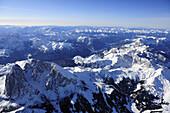View at Langkofel, Fuenffingerspitze, Plattkofel and Seiseralm in winter, Pala range, Lagorai range and Latemar range in background, aerial photo, Dolomites, South Tyrol, Italy, Europe