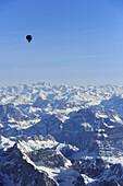 Hot-air balloon flying high above Dolomites and Tauern range with Grossglockner, aerial photo, Dolomites, Venetia, Italy, Europe