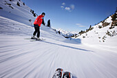 Woman skiing downhill, Galtuer, Paznaun valley, Tyrol, Austria