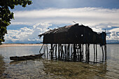 House on Stilts on Island near Sorong, Raja Ampat, West Papua, Indonesia