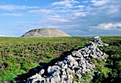Summit of Knocknarea Mountain, Sligo, Ireland, topped by Queen Maeve's Cairn, a massive Neolithic Iron Age passage tomb