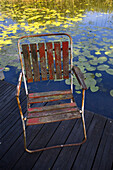 Weathered garden chair on a jetty