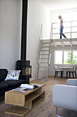 Woman in the livingroom, modern design of a residence
