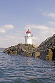 Lighthouse at rocky coast