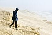 Man on sand dunes, Rubjerg, Jutland, Denmark