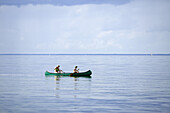 Mother and son paddling a canoe