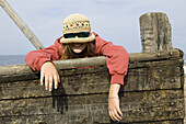 Girl with sunglasses and straw hat
