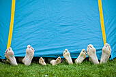 Feet sticks out from a tent