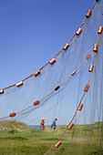 Fishing net hangs up to dry