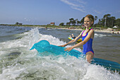 Girl playing in waves