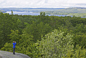 Boy with binoculars on rock