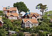 Red houses with Swedish flags, Karlskrona, Blekinge, Sweden